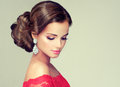 Young, gorgeous model dressed in a red gown.