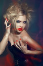 Young gothic girl with red lips and nails Stock Images