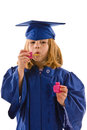 Young graduate her cap gown blowing bubbles dripping bubbles down her graduation gown isolated white vertical layout copy space Royalty Free Stock Photo