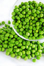Young green peas Stock Images