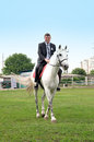 The young groom riding on a white horse Royalty Free Stock Photo