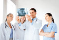 Young group of doctors looking at x ray picture Stock Photography