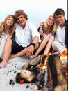 Young group of people at the beach having fun Stock Photography