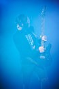 Young guitarist performing on stage smoky scenic Stock Images