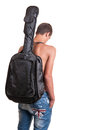 Young guitarist wearing no top with his acoustic guitar on back Royalty Free Stock Photo