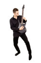 A young guy in black clothes plays the guitar Royalty Free Stock Image