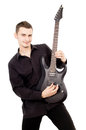 A young guy in black clothes plays the guitar isolated on white background Stock Photography