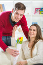 Young guy brings flowers to his girlfriend selective focus Stock Photography
