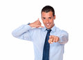 Young guy with calling sign pointing Stock Image