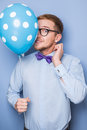 Young guy with a colorful balloon in his hand. Party, birthday, Valentine