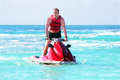 Young guy cruising on a jet ski Royalty Free Stock Photo