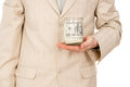The young guy keep glass jar with the money Stock Photo