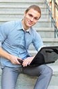 Young guy with a laptop Royalty Free Stock Images