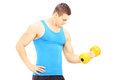 Young guy lifting a dumbbell isolated on white background Royalty Free Stock Image