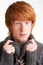 Young guy portrait of attractive redhead looking at camera Stock Photos