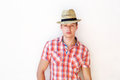 Young guy posing with hat against white background portrait of a Royalty Free Stock Photos