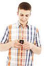 Young guy sending a sms with his mobile phone Royalty Free Stock Photos