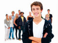 Young guy smiling with friends in the background Stock Images