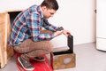 Young guy squatting and opened the safe looks at the puzzle tryi Royalty Free Stock Photo