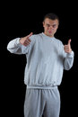 Young guy in a track suit on a black background Royalty Free Stock Images