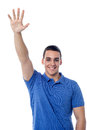 Young guy waving hi to his friend handsome man friends Royalty Free Stock Image