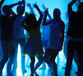 Young guys and girls dancing at a nightclub Royalty Free Stock Photography