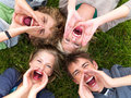 Young guys and girls shouting Royalty Free Stock Image