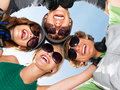 Young guys and girls in sunglasses Royalty Free Stock Photography