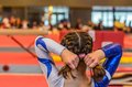 Young gymnast girl fixing hair before appearance Royalty Free Stock Photo