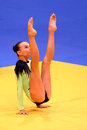 Young gymnast performing a floor exercise demonstration during the break of the european judo championships for individual juniors Royalty Free Stock Photos