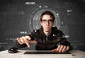 Young hacker in futuristic enviroment hacking personal informati information on tech background Stock Image