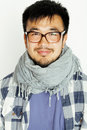 Young handsome asian man hipster in glasses on white background smiling, modern lifestyle concept Royalty Free Stock Photo