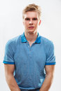 Young handsome blond man wearing shirt portrait of against grey background Royalty Free Stock Images