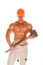 Young and handsome builder with a sledgehammer and Stock Image