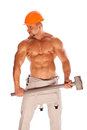 Young and handsome builder with a sledgehammer and Royalty Free Stock Photography