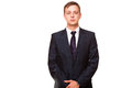 Young handsome businessman in black suit is standing straight, portrait isolated on white background Royalty Free Stock Photo