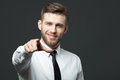 Young handsome businessman pointing at you  isolated on gray bac Royalty Free Stock Photo