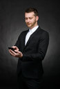 Young handsome businessman using smartphone Royalty Free Stock Photos