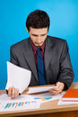 Young handsome businessman working with documents Royalty Free Stock Photos
