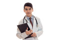 Young handsome doctor in blue uniform with stethoscope on his neck make notes isolated on white background Royalty Free Stock Photo