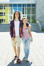 Young handsome friend student at the college two friends outdoors Royalty Free Stock Photography
