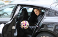 Young handsome groom sitting in a car on his wedding day Royalty Free Stock Photo