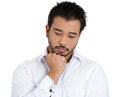 Young handsome guy worried or upset about something deeply thinking about it closeup portrait of sad bothered stressed man chin on Stock Photo
