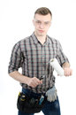 Young handsome handyman white background a man in studio tools and businesslike serious and with a smile Royalty Free Stock Photography