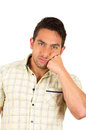 Young handsome hispanic man bored Royalty Free Stock Photo