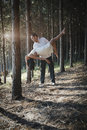 Young handsome Indian couple dancing in forest wearing white Royalty Free Stock Photo