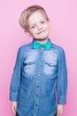 Young handsome kid smiling with blue shirt and butterfly tie. Studio portrait over pink background Royalty Free Stock Photo