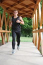 Young handsome man athlete running park Stock Image
