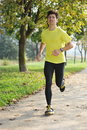 Young handsome man athlete running park Stock Photo