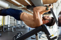 Young handsome man doing exercise for abdominal muscles